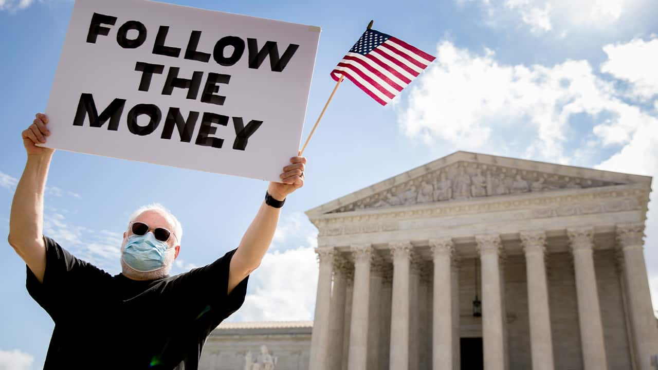 Photo of a man outside the Supreme Court