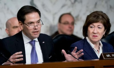 Photo of Sen. Marco Rubio, R-Fla., left, accompanied by Sen. Susan Collins, R-Maine, right
