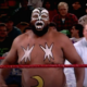 """Photo of professional wrestler James """"Kamala"""" Harris in the ring with a referee"""