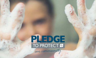 Image of a man with soap-covered hands pledging to stop the spread of COVID-19