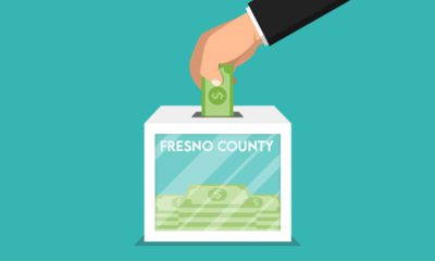 Illustration of hand putting dollars bills into a ballot box titled Fresno County