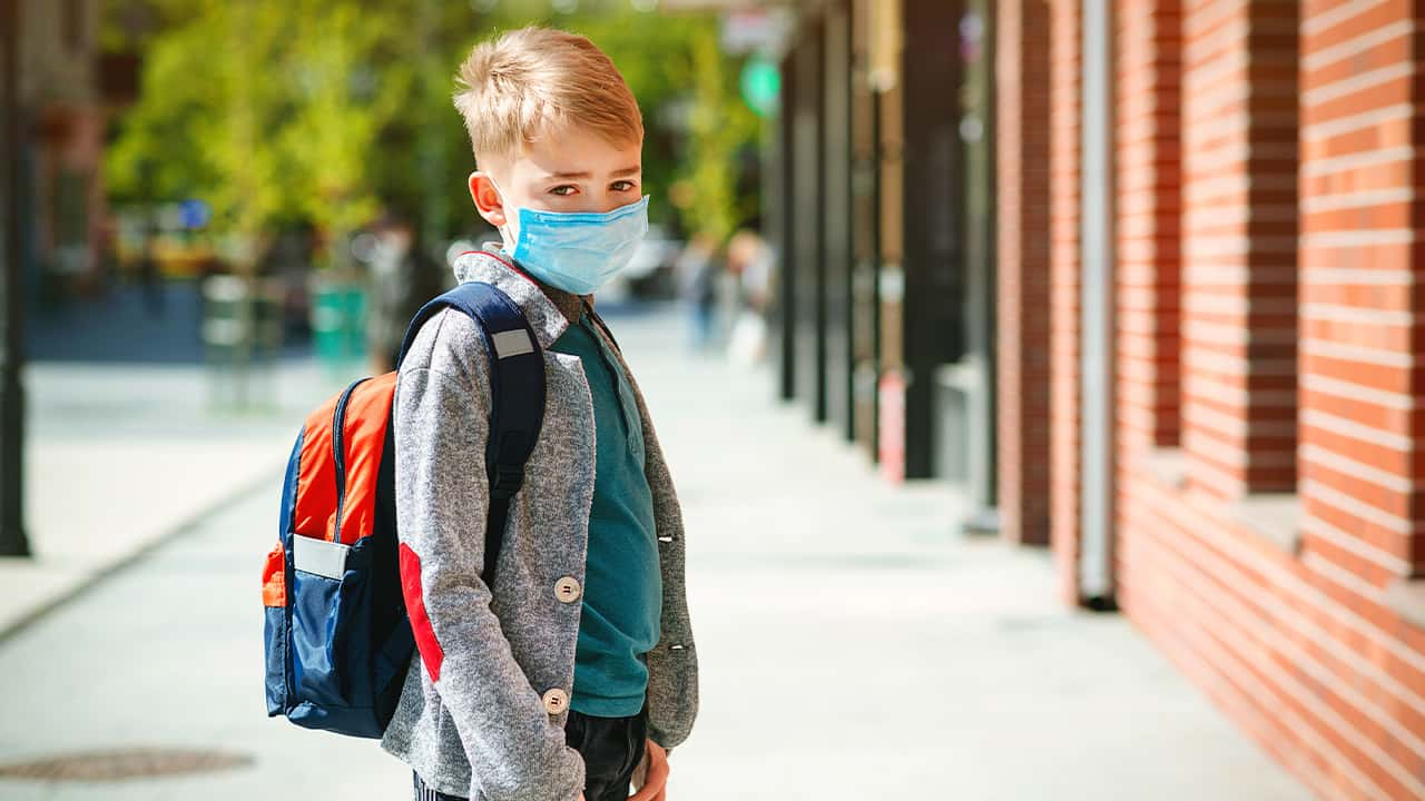Photo of a kid at school