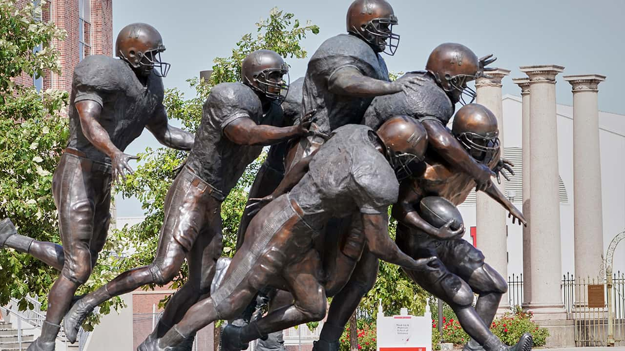 Photo of a statue of football players