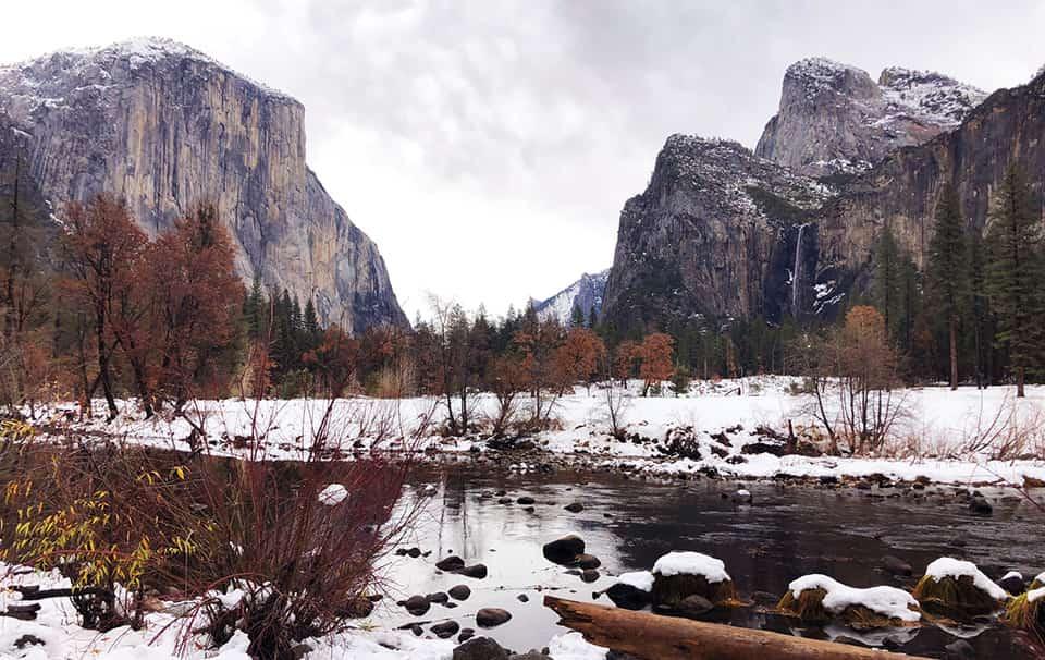 Snow blankets the Yosemite Valley floor during winter.