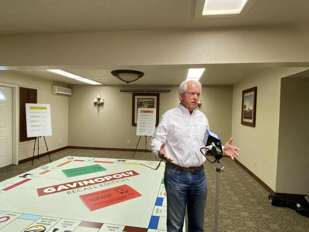 """John Cox displayed his giant 'Gavinopoly"""" board at a stop in Fresno on Friday. (GV Wire/David Taub)"""